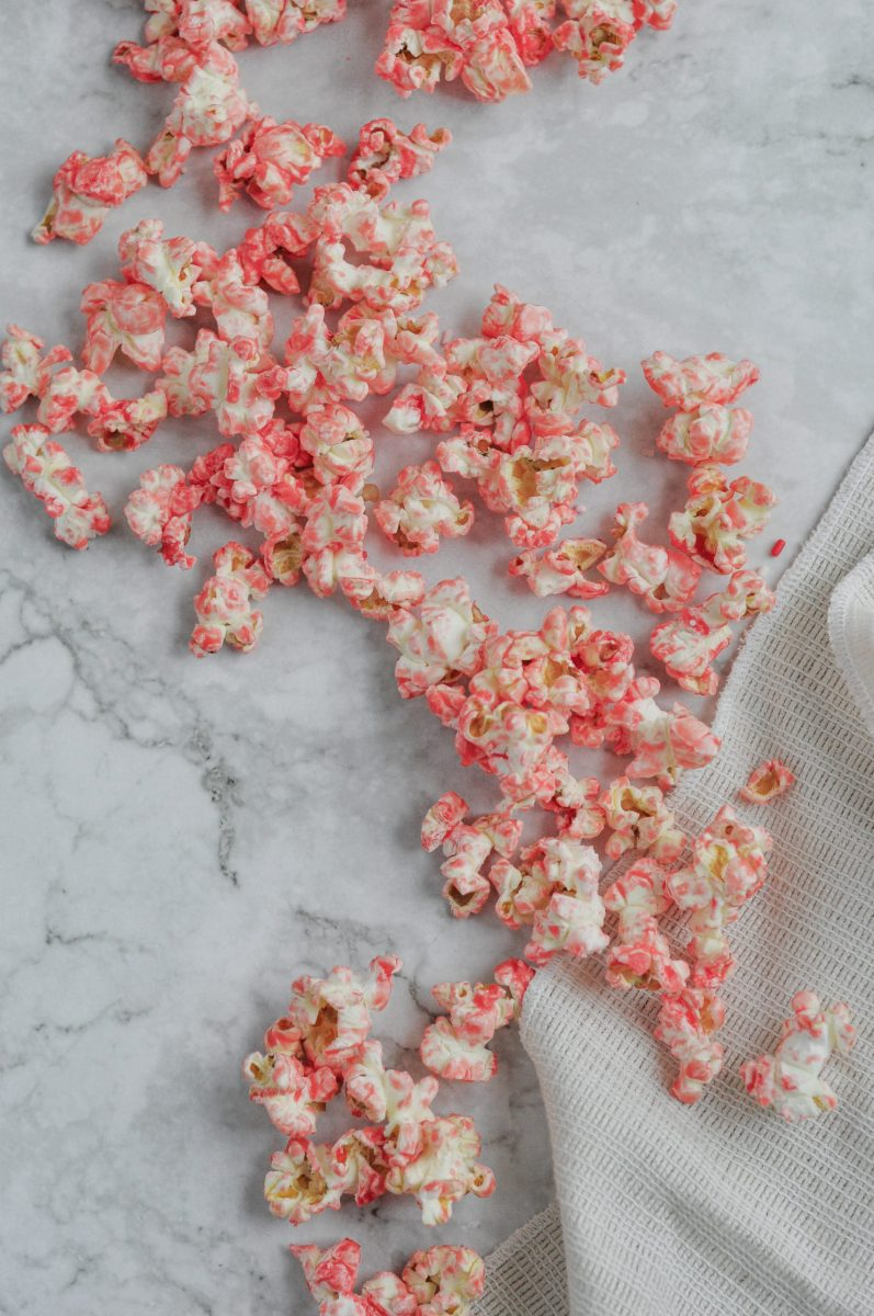 pink popcorn saying on a marble countertop.