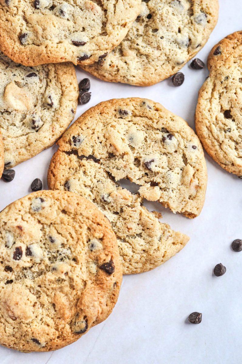 A close-up shot of peanut butter chocolate chip cookies with one cookie broken in two.