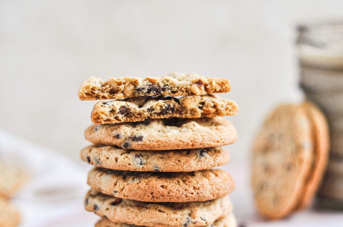 A close up shot of a stack of peanut butter chocolate chip cookies
