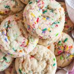 A close-up of sugar cookies full of bright colored sprinkles