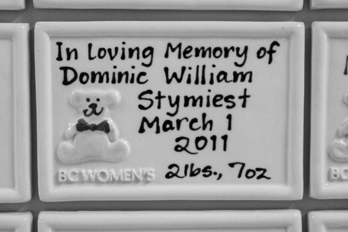 A black and white photo of a memory tile for a premature baby.