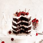 Four rich layers of dark chocolate cake. Whipped cream between each layer and topped with fresh cherries.